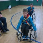 Image of Beavers trying out wheelchairs normally used to play basketball
